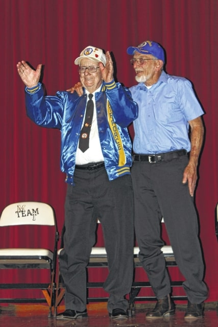 Frank Wood Sr. (left), a 91-year-old World War II veteran, was honored Friday morning during the Miami Trace Veterans Day Breakfast and Assembly. From being stranded in the middle of the ocean for nearly 12 hours to assisting with the invasion of D-Day as a carbine sharpshooter, Wood was in the thick of the war. He is pictured with his son, Frank Wood Jr., a veteran of Korea and Vietnam.