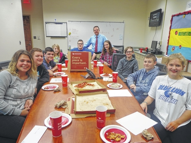 """Donatos recently provided pizza to these students at Washington Middle School as they celebrated """"Pizza with the Principals."""" This is in appreciation for their selection as Students of the Month for November. They are chosen by their teachers because of the outstanding example they set for their peers in such areas as academic effort, good work ethic, kindness to others, and service to their school. Pictured from left: Destanie Leach, Hartley Larch, Caden Shiltz, Kascidy Carter, Dakota Oyer, Mr. Montgomery, assistant principal, Rachel Palmer, Preston Hines, Braden Penwell and Kassie Wiseman."""