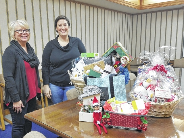 Fayette County Chamber board chair Merleen Van Dyke (left) congratulations Erin Weber for winning the Elf on the Shelf Christmas Giveaway.