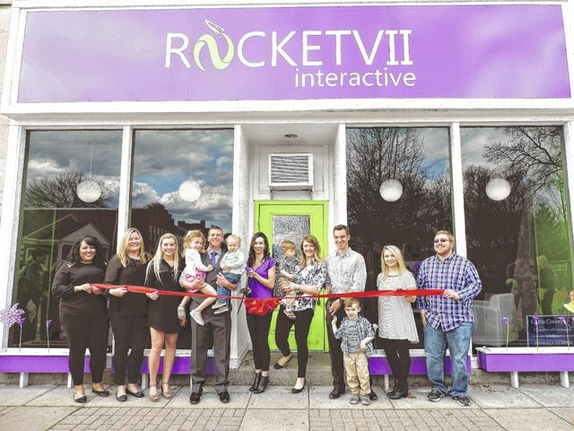 Members of the Rocket VII team cut the ribbon to announce their new outdoor digital billboard company in Fayette County.