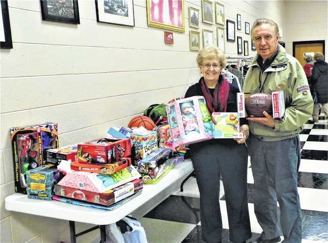 When the Fayette County Retired Teachers gathered for their final meeting of the year, one of the two service projects in which they participated on that December day was bringing in toys for children at The Well at Sunnyside. Many toys! Here Diana Febo, co-chair of the organization's Community Service committee, and her husband Paul begin the process of sorting and counting the new Christmas gifts donated by the approximately 50 members who attended the December luncheon, catered by Grace United Methodist Church. Also on the Community Service committee are co-chair Sandi Clawson, Janet Martin and Nancy Mowery.