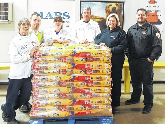 The Fayette Humane Society and Mars Petcare partnered to send over 1,000 pounds of pet food to the fire victims in Tennessee. Pictured (L to R): Mars Petcare representatives Charmie Coleman, Nick Wilson, Carolyn Thornton, and Brian Crooks with Humane Officer Danyel Bageant and Humane Officer & Outreach Director Brad Adams.