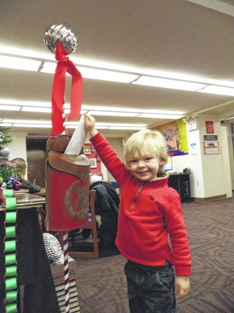 Max, almost 4-years-old, recently dropped off his Letter to Santa at the Carnegie Public Library's Children's Department.