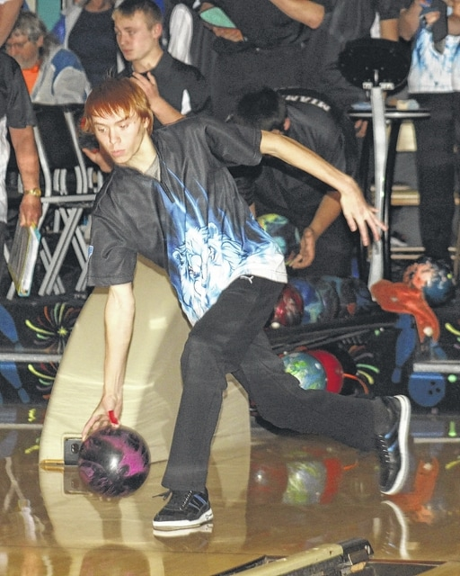 Grant Mustain sends a ball down the alley for the Blue Lions in an SCOL match against Miami Trace Wednesday, Nov. 30, 2016 at LeElla Lanes.