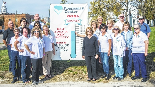 Board members and volunteers recently met at the site for the new LIFE Pregnancy Center to raise the thermometer and celebrate reaching 80 percent of the total project goal.
