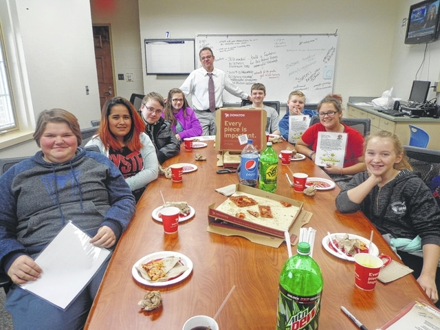 "Donatos recently provided pizza to these students at Washington Middle School as they celebrated ""Pizza with the Principals."" This is in appreciation for their selection as Students of the Month for December. They are chosen by their teachers because of the outstanding example they set for their peers in such areas as academic effort, good work ethic, kindness to others, and service to their school. Pictured from left: Lindsey Warnock, Nakhia Pacheco-Vasquez, John Rife, Natosha Rayburn, Mr. Montgomery, Assistant Principal, Brayden Howard, Reece Self, Stephany Matheny and Arianna Heath. Absent the day of picture was Jacob Moore."