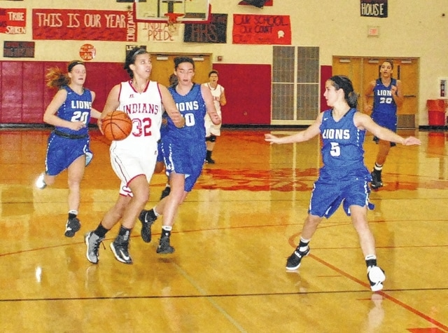 Hillsboro's Kaley Burns (32) takes a look at the basket, guarded by Washington's Kassidy Hines during an SCOL game at Hillsboro High School Wednesday, Dec. 14, 2016. Also pictured for Washington are (l-r); Tabby Woods (20) and Savannah Wallace (10).