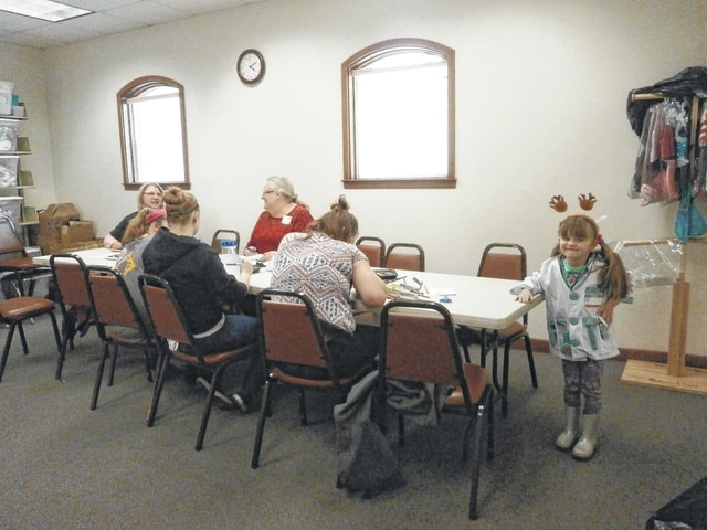 """Jeffersonville Branch Library was the place to be for Miss Linda's Kiwi CD Calendar craft as well as playing dress up with Miss Gabriella (end of table), posed as a doctor for the camera. The library would also like to mention that, sadly, this was Miss Linda's last craft session as she is retiring after 10 """"spectacular"""" years of service at the library."""