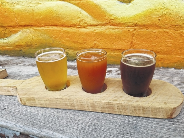 Guests can sample a flight of brews made by the brewery. From left: Zip Code, IPA, and Downtown Brown.
