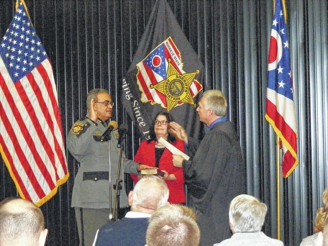 Fayette County Sheriff Vernon Stanforth was sworn in Sunday by Fayette County Probate Court Judge David Bender. Stanforth's wife, Joy, is pictured assisting in the ceremony.
