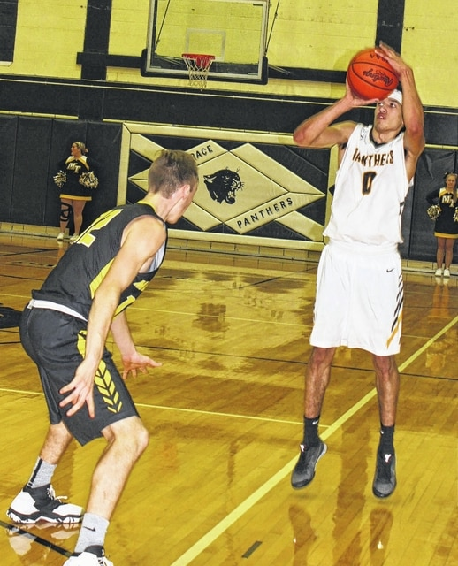 Miami Trace senior DeAndre Pettiford, at right, sets for a long-range three-pointer against Lynchburg-Clay junior Eric McLaughlin during a non-league game to open the 2017 portion of the season Tuesday, Jan. 3 at Miami Trace High School. Pettiford scored a season-high 24 points to lead the Panthers to the win.