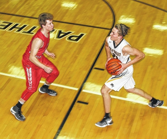 Miami Trace senior Jacob Batson (right) takes the ball to the basket against East Clinton during an SCOL game Tuesday, Jan. 10, 2017 at Miami Trace High School.
