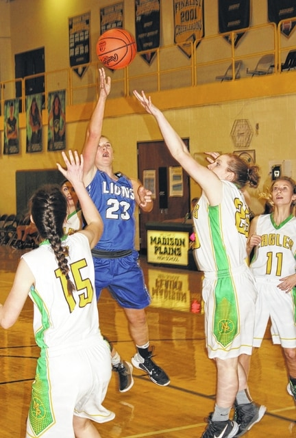 Washington freshman Shawna Conger puts up a shot while guarded by two Madison Plains players during a non-league game at Madison Plains High School Monday, Jan. 9, 2017.