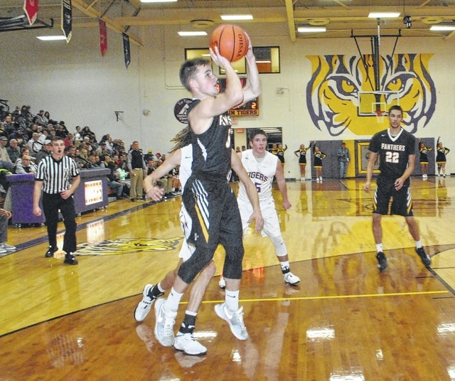 Miami Trace's Mitchell Creamer sets up a shot Friday, Jan. 6, 2017 against the McClain Tigers in Greenfield. Pictured at right for the Panthers is Keondrick Bryant.