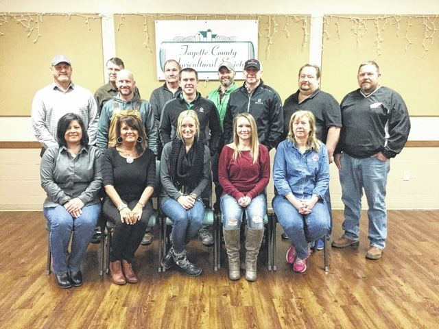 The Fayette County Agricultural Society raffle drawing and dance sponsors recently met for a picture. The sponsors include: front row: Mallory Breiner, Metzer Insurance; Pam Langley-Pittel, Morgan Pentzer Lewis and Langley Realty; Stephanie Whipp, Roosters and Diane Amore, Amore Pizzeria. Second row: Larry Sowers, Metzger Insurance; Scott Pfeifer, Quality Collision; Andrew Bond, Gustin Seed Service; Brian McCoy, Beck's Seed (ticket sponsor); Ron Amore, Amore Pizzeria and Gregg Pettit, Ag Society Director . Third row: Wayne Arnold, Ag Society Directory; Dennis Garringer, Crop Production and Doug Coe, Gustin Seed Service.