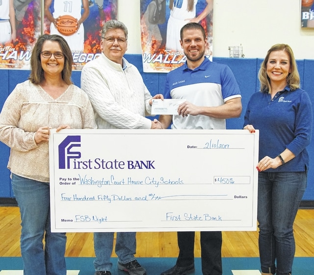 Mark Richards, Karen Cassidy and Ellie Zint from First State Bank recently made a check presentation to Jon Creamer, athletic director at Washington High School.
