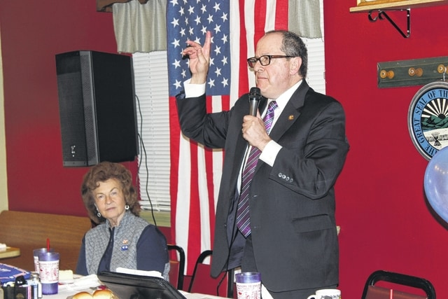 State Rep. David Leland speaks to the patrons of the Fayette County Democratic Party Executive Committee Obama Legacy Dinner Sunday evening. He is pictured with executive committee chair Judy Craig.