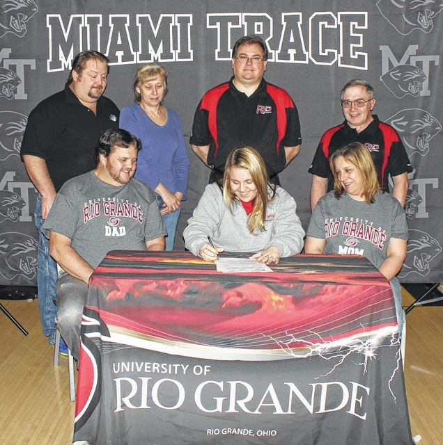 Miami Trace High School senior Macy Detty, seated, middle, signed a letter of intent on Wednesday, Feb. 15, 2017, to attend the University of Rio Grande where she will be a member of the women's bowling team. She is flanked by her parents, Scott and Sissy Detty and joined by Ron Amore Jr., Diane Amore, of LeElla Lanes and Rio Grande head coach Bret Little and assistant coach Phil Karl.