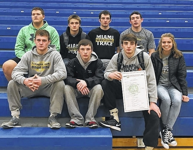 Miami Trace's District qualifiers are shown in the stands at Washington High School following the Sectional tournament Saturday, Feb. 25, 2017. (front, l-r); Jack Anders, Storm Duffy, Coby Hughes and statistician Cassidy Tolliver; (back, l-r); Colin Wolffe, James Munro, Dereck Moore and Jared Fenner. Not pictured are alternates Dalton Bartley and Dylan Murphy.