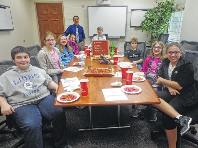 "Donatos recently provided pizza to these students at Washington Middle School as they celebrated ""Pizza with the Principals."" This is in appreciation for their selection as Students of the Month for January. They are chosen by their teachers because of the outstanding example they set for their peers in such areas as academic effort, good work ethic, kindness to others, and service to their school. Pictured from left: Brendan Walter, Caroline Frederick, Meredith Pabst, Emily Semler, (Troy Montgomery, assistant principal) Owen Mullins, Ethan Campbell, Kaitlyn Carr and Arianna Bagheri."