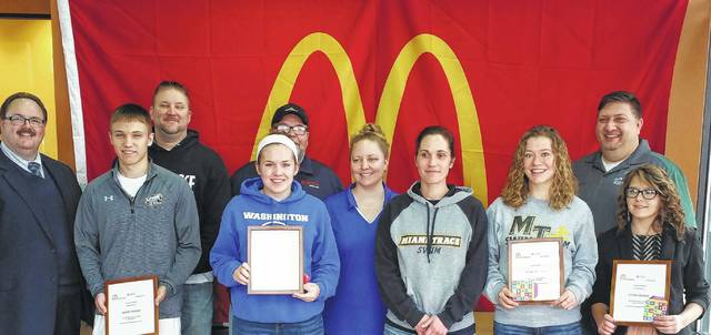 McDonald's of Fayette County honored the 2017 Winter Scholar Athletes Saturday. Pictured: row one: Blake Pittser—Miami Trace, boys basketball (MT Male Student-Athlete), Grace Gerber - Washington C.H., girls swimming (WCH Girls Student-Athlete), Katie Kasberg-Washington Court House Swim Coach, Mary Miller-Miami Trace Swim Coach, Clare Sollars-Miami Trace Girls Swimming (MT Female Student-Athlete) and Elena Olaker-Fayette Christian School, girls basketball (FCS Girls Student-Athlete). Row two: Nick Epifano - McDonald's Owner/Operator, Rob Pittser - Miami Trace Boys Basketball Head Coach, Harry Wright - WCHO Radio and Jeremy Olaker - Fayette Christian School Athletic Director/basketball coach. Winners not pictured: Washington Court House Spencer Minyo, boys swimming and Fayette Christian School Aaron Turner, boys basketball.