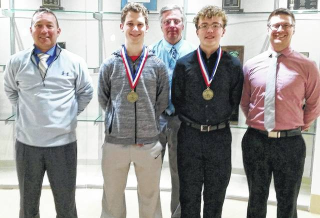 From left to right, Washington High School Principal Tracy Rose, DECA State winner, Seth Hamusik, DECA advisor, David Penwell, DECA State winner, Jaxon Singleton, and assistant principal Jon Hemmelgarn.