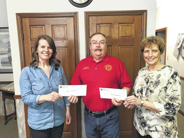 Gary Spears from the Good Hope Lions Club recently made scholarship presentations to Miami Trace and Washington C.H. students. On the left accepting the check for Washington C.H. is Mallory Bihl and on the right accepting the check for Miami Trace is Carol Waddle.