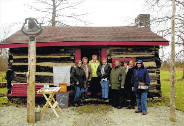 Pictured are the Deer Creek Daisies Garden Club members who visited Caesar Creek Pioneer Village for a maple syrup and pancake brunch. They are shown standing in front of the Pioneer School. From left to right, Jeanne Miller, Connie Lindsey, Judy Gentry, Kendra Knecht, Joyce Schlichter, Barbara Vance, Billie Lanman and Julie Schwartz. The planned March meeting was hosted by Connie Lindsey and Barbara Vance.