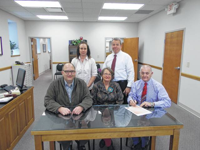 Front row, left to right, Washington C.H. City Manager Joe Denen, program coordinator for Master Gardeners, Sara Creamer, and Fayette County Commissioner Jack DeWeese; back row, Natural Resource Specialist Fayette SWCD Brigitte Hisey and Fayette County Commissioner Tony Anderson.