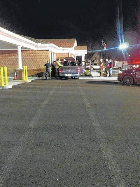 Police officers and firefighters responded to the scene Wednesday evening after the truck crashed into the bank building.