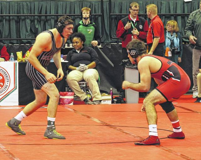 Miami Trace senior Jared Fenner (at left) faces Wauseon senior Tony Banister in a Division II championship quarterfinal match at 195 pounds on day two of the State wrestling tournament at The Ohio State University in Columbus Friday morning, March 10, 2017.
