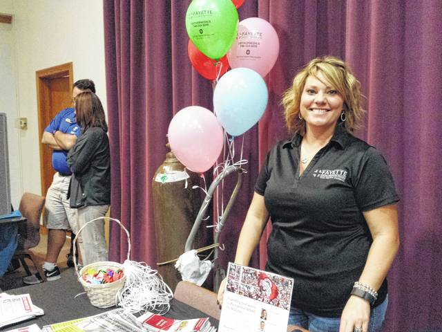 The 27th-annual Health Fair and Family Fun Day will be held at the Grace Community Church on Saturday, April 29 from 8 a.m. to 2 p.m. This photo was taken from last year's event and features Fayette County Memorial Hospital Director of Business Development, Chelsie Hornsby, who was handing out information and balloons.