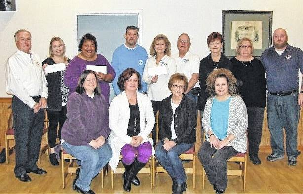 Washington Court House Elks Lodge 129 recently donated proceeds from their annual Holiday Breakfast to the Well at Sunnyside, The Warehouse, the Fayette County Food Pantry, Buckeye Bikers' Association and Life Pregnancy Center. The annual breakfast is in its 38th consecutive year. Money was also donated to the Elks National Foundation and the Elks National Cerebral Palsy Fund. Breakfast chairman and Elks' trustee Rowland LeMaster, on behalf of the trustees and officers of the Elks, would like to thank the community and the members of the Elks for supporting this event, making it another successful year enabling the Lodge to continue their motto of Elks Care-Elks Share. Front row, representing Life Pregnancy Center, left to right: Nora Debruyn, Shawn Lachat, Patty Cox and Diane Farris Munro. Back row, left to right: Rowland LeMaster (Elk's 129); Molly Gruber (The Warehouse); Chaquita Nash (The Well); Barry Hidy, Barbara Fox, Larry Shriver (Life Pregnancy Center); Karen Bloedel (Fayette County Food Pantry; Sandy Rodgers (Buckeye Biker's Association) Scott Mullen (Exalted Ruler Elk's Lodge 129).