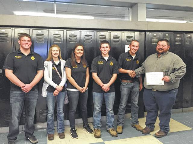 From left to right, the Miami Trace FFA officer team pictured with Dale Mayer of Mayer Farm Equipment as their are presented a grant of behalf of the National FFA Organization sponsored by AGCO Corporation. Cole Karnes, Abbygail Pitstick, Makayla Eggleton, Garrett Hagler, JM Perrill and Mayer.