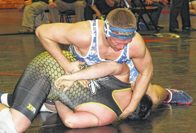 Washington senior Trevor Hicks puts Taylor senior Andrew Profitt in an uncomfortable position prior to pinning him in the first round of the Division II District tournament Friday, March 3, 2017 at Wilmington High School. Hicks went 4-0 to win the District title, improving his season record to 50-2.