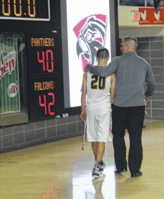 FATHER AND SON — Miami Trace senior Blake Pittser and head coach Rob Pittser walk past the scoreboard as they exit the floor at the Convocation Center at Ohio University Saturday, March 11, 2017.