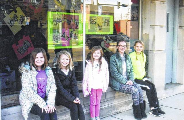 """The All-N-One 4-H Club found the Fayette Travel Centre window the perfect place to """"Find your Fit in 4-H."""" Club members that decorated the window were (L to R): Peyton Johnson, Cali Kirkpatrick, Karlee Johnson (Cloverbud), Madison Johnson and Hidy Kirkpatrick. Also, they would like to thank Peg Reiterman for letting them find our fit."""