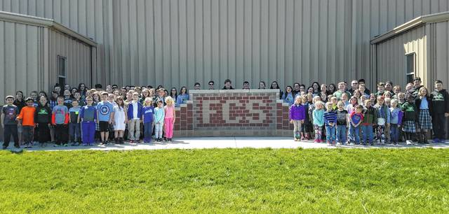 """After a recent successful Fayette Christian School auction where they raised $24,000, the students gathered to thank the community for their support of the fundraiser. Pictured are students from all grades who gave a big """"Thank you,"""" while taking the photo."""