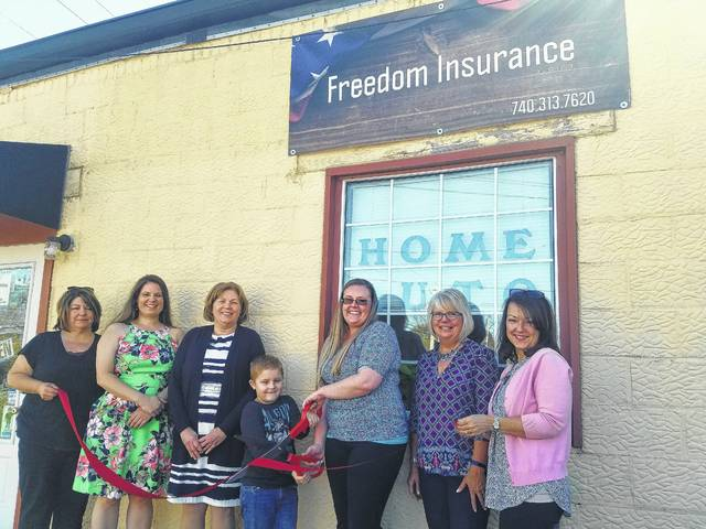 Stephanie Summers of Freedom Insurance and son Waylon cut the ribbon on their new business with the help of Chamber Ambassadors.