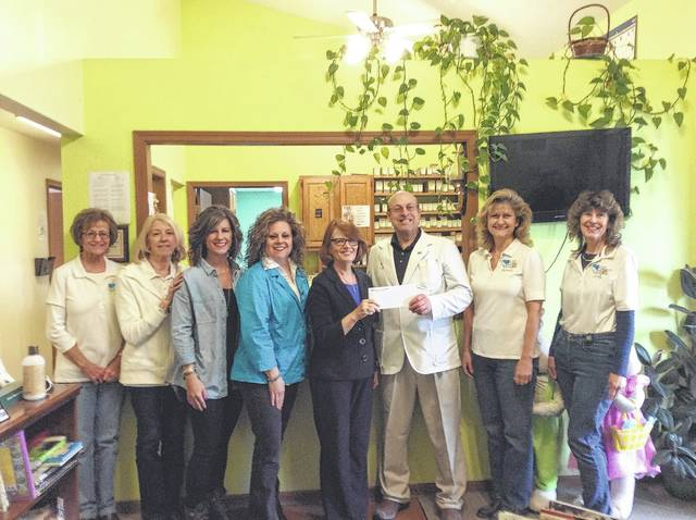 "Chiropractic Health & Wellness Center recently held a ""Patient Appreciation Week"" and all proceeds from the event were donated to the LIFE Pregnancy Center. From left to right, Patti Cox, Carol West, Mandy Waters, Diane Faris Munroe, Patty Griffiths, Dr. Greg Flerchinger, Barbara Fox and Cindy Knauff."