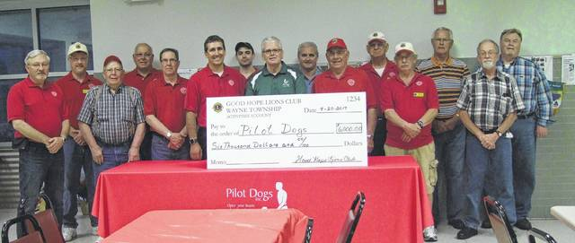 Several members of the Good Hope Lions traveled to Pilot Dogs in Columbus recently to tour the new facility and present the organization with a contribution.