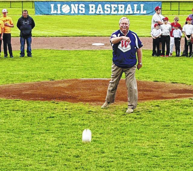 John Meriweather, former president of the Washington Little League, threw the first pitch of the Blue Lion baseball game versus East Clinton Friday. As a member of the Rotary Club, Meriweather has volunteered his time for over 40 years as Little League coordinator.