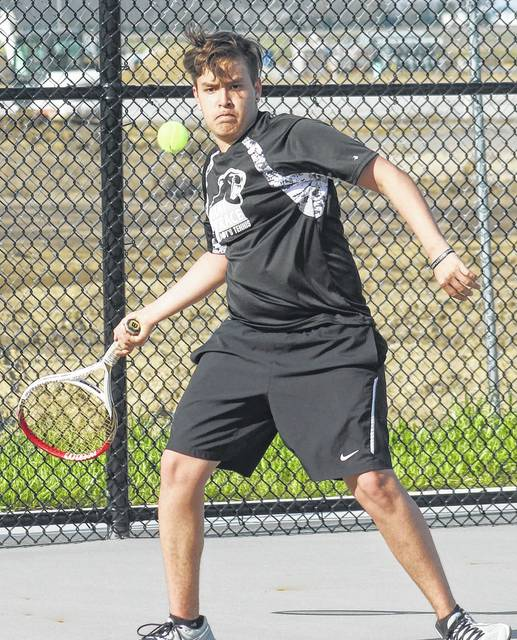 Miami Trace's Juan Diego Navas is about to hit a return during his first singles match against Washington's Kenny Upthegrove Wednesday, April 12, 2017 at Miami Trace High School.