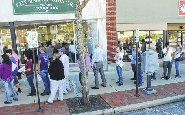 The line of residents waiting to file city income taxes stretched outside the City of Washington Court House building as it approached 4 p.m. Tuesday. April 18 was Tax Day, a colloquial term for the day on which individual income tax returns are due to the government.