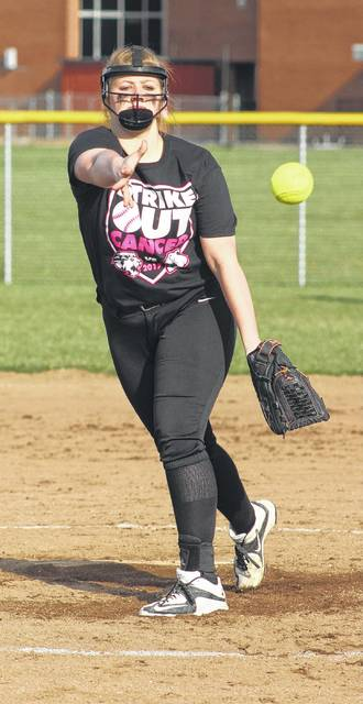 Miami Trace sophomore Maddie Mossbarger delivers a pitch during an SCOL game against the Washington Lady Blue Lions Wednesday, April 12, 2017 at Miami Trace High School.