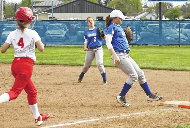 Maddy Jenkins makes the play at first base for Washington during an SCOL game against Hillsboro Monday, April 24, 2017. Also pictured for Washington is Maddison Osborn.