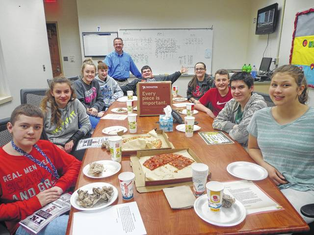 """Donatos recently provided pizza to these students at Washington Middle School as they celebrated """"Pizza with the Principals."""" This is in appreciation for their selection as Students of the Month for March. They are chosen by their teachers because of the outstanding example they set for their peers in such areas as academic effort, good work ethic, kindness to others, and service to their school. Pictured from left: Mason Cottrill, Morgan Michael, Mallory Hicks, Brooklyn Foose, (Mr. Montgomery, Assistant Principal), Wes Pickering, Jessika Young, Tyler Tackage, Chris Runnels and Joshalynn Worth. Absent from photo was Logan Bailey."""