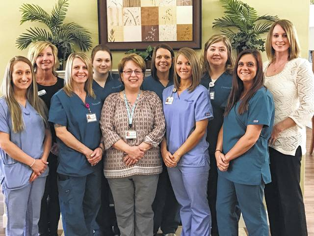 Whitney Pennington (center) with her Heartland Hospice team from left are Megan Jackson, Holly Cottrill, Tracy Thomas, Tiffany Kearns, Pennington, Amanda Everhart Liming, Sabrina White, Cathy Keaton, Leslie Gloyd and Angela Tackett.