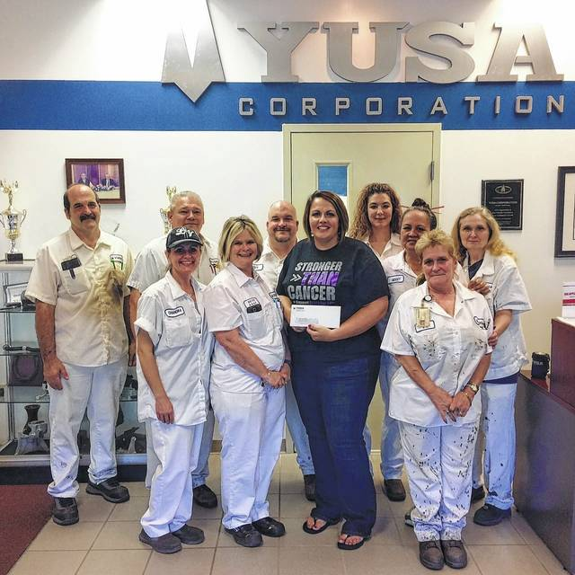 """Melinda Daniels from the American Cancer Society receives a sponsorship check from YUSA Corporation for the upcoming Fayette County Relay for Life. The Relay for Life is scheduled for June 9 at 6 p.m. at the Washington High School track. Part of YUSA's Relay Team, the """"Walking Warriors,"""" is pictured with Daniels. The YUSA Team challenges other local companies to put a team together and participate at the Relay this year. Cancer strikes all of us in some form, whether it be you or a family member or a friend. Join in to help raise awareness and money to find a cure. The Relay for Life is the largest fundraiser for the American Cancer Society."""