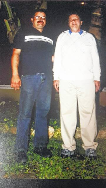 Paul Desanto and Ralph The Tire Man at a trip in Cancun, Mexico after winning a tire selling contest years ago.